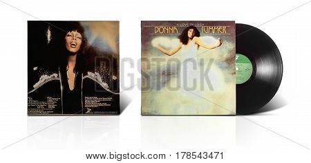 Rishon LeZion Israel-August 31 2016: Old vinyl stereo album A Love Trilogy Donna Summer. Manufactured by HaTaklit Ltd Haifa Israel in 1976. Covers and vinyl disc are shooted on white background