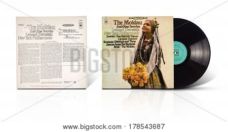 Rishon LeZion Israel-August 31 2016: Old vinyl stereo album The Moldau and other favorites New York Philharmonic Leonard Bernstein conductor. Manufactured by CBS Records Tel Aviv Israel. Covers and vinyl disc are shooted on white background