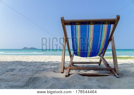 Abstract canvas chair on beach beach chair on blue sea with nature background vacation and holiday concept with copy space