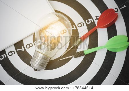 lightbulb on dartboard with arrow. concept goal for new ideas with innovation and creativity.