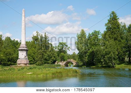 A view of the Chesme obelisk and the Humped bridge on the Gatchina palace park. Leningrad region, Russia