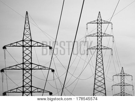 Hanging cables and electric towers, lines and shapes, monochrome effect