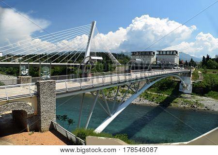 White bridge with one pillars that hold large cable landscape