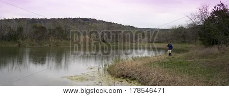A Photographer Shoots Cattail Pond at Cedar Ridge Preserve managed by Audubon in Dallas Texas.