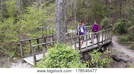 DALLAS, TEXAS, MARCH 16. The Cedar Ridge Preserve on March 16, 2017, in Dallas, Texas. A Pair of Women Hike Cedar Ridge Preserve managed by Audubon in Dallas, Texas.