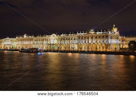 SAINT PETERSBURG, RUSSIA - AUGUST 09, 2016: The Winter Palace in night illumination on cloudy August night