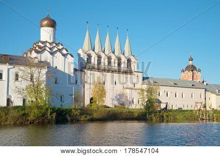 View of a belltower of the Tikhvin Uspensky monastery in the October evening. Tikhvin, Russia