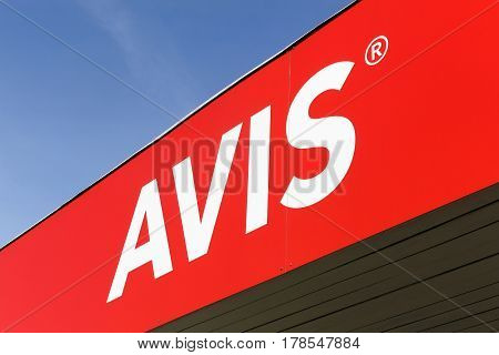 Vejle, Denmark - March 25, 2017: Avis logo on a wall. Avis is an American car rental company headquartered in New Jersey, United States