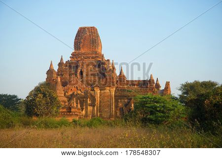Ancient Buddhist pagoda Tha Kya Pone in the light of the morning sun. Bagan, Myanmar