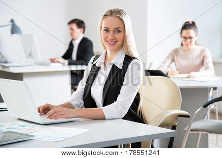Businesswoman working with computer in an office