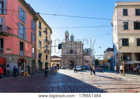 MILAN ITALY - September 12 2016: Tourists and local people are crossing street near Santa Maria della Vittoria .