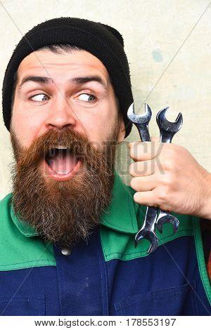 Bearded Brutal Caucasian Mechanic Holding Metallic Wrenches