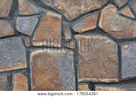 The wall revetted with stones of various geometrical form