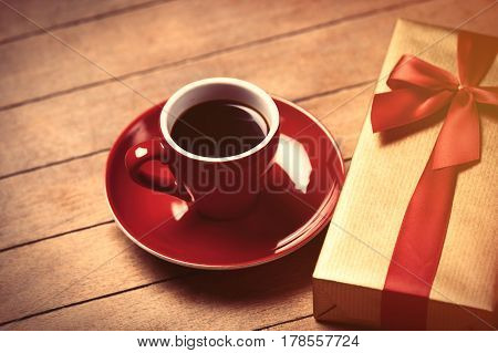 Photo Of Cup Of Coffee And Cute Wrapped Gift On The Wonderful Brown Wooden Decoration