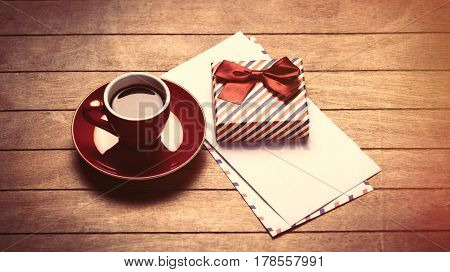 Photo Of Cup Of Coffee, Envelopes And Cute Wrapped Gift On The Wonderful Brown Wooden Background
