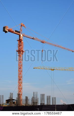 large cranes at the site of construction of buildings