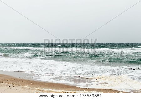 Sea view from the beach in windy weather soft focus