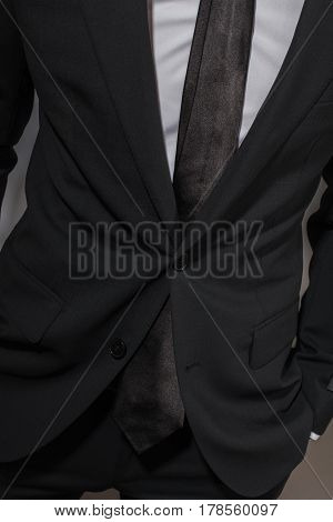 A Man In A Black Suit And A White Shirt