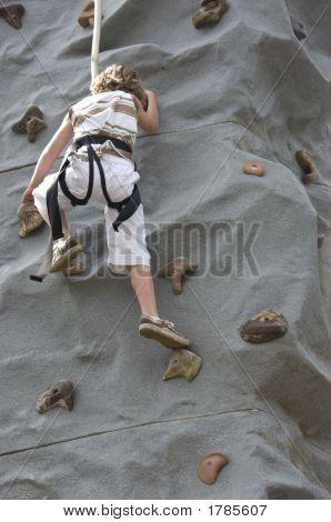 Boy Climbing Rock Wall 2