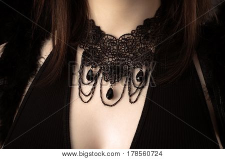 beautiful black ornament on neck of girl