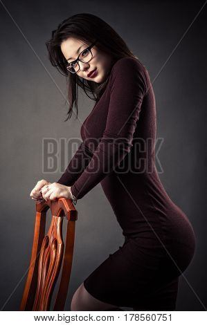 beautiful fashionable young girl in dress in studio