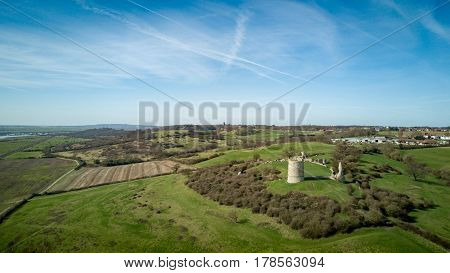 Aerial view over the Essex countryside with the 13th Century ruins of Hadleigh Castle in view.