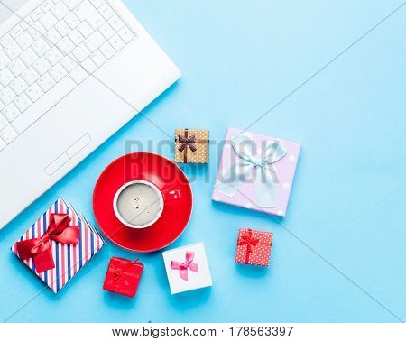 Cute Gifts, Laptop And Cup Of Coffee On The Wonderful Blue Background