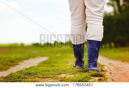 low view of farmer walking along the rural countryside road