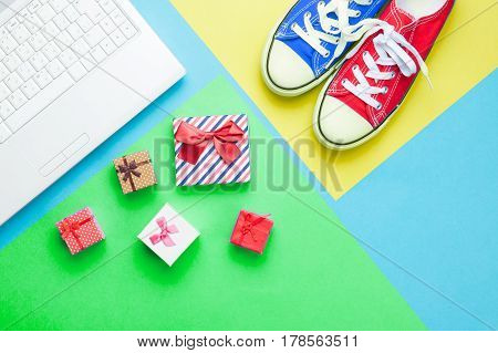 Cute Gifts, Gumshoes And Silver Laptop On The Wonderful Colorful  Background In Pop Art Style