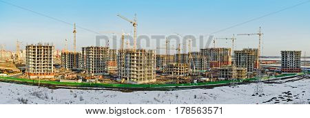Panoramic view of the construction of residential houses in the microdistricts.