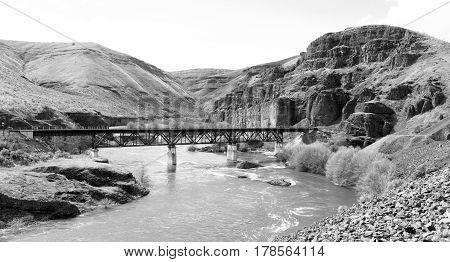 A Railroad Tressle Bridge spans the Deschutes River in Oregon State USA North America