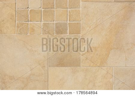 Close up of beige tiles of different size backround texture