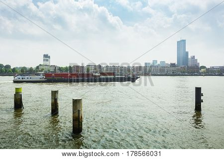 Rotterdam Netherlands - May 26 2016: Container ship passes the Nieuwe Maas river in Rotterdam