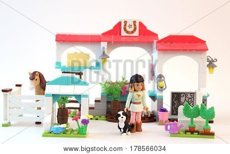 Colorado, USA - March 26, 2017: Studio shot of Mega Construx American Girl Nicki's Horse Stables with horse, girl, and dog isolated on white background.
