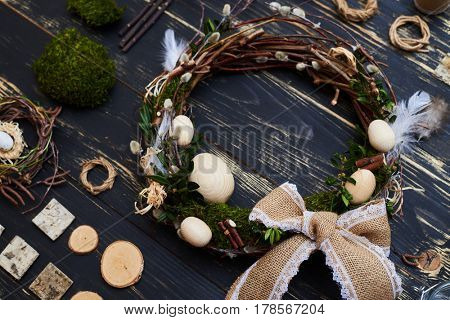 Flat lay, workplace for handcraft creative materials to make an Easter wreath