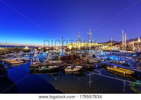 KYRENIA, NORTH CYPRUS - MARCH 26, 2017: Night view of Kyrenia (Girne) harbour. Kyrenia harbour is a one of the most popular tourist attractions in  Cyprus.