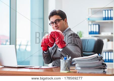 Angry aggressive businessman with boxing gloves