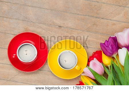 Photo Of Cups Of Coffee And Colorful Tulips On The Wonderful Brown Wooden Background