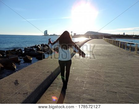 Girl walking in the coast of Barcelona
