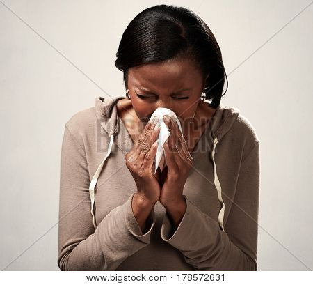 sneezing black woman