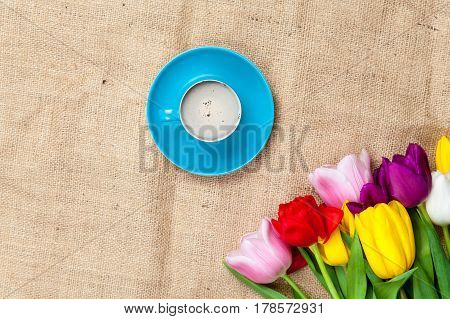 Photo Of Beautiful Bunch Of Colorful Tulips And Cup Of Coffee On The Wonderful Brown Wooden Backgrou