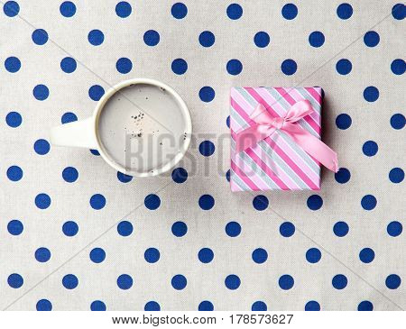 Photo Of Cup Of Coffee And Cute Gift On The Wonderful White Dotted Background In Pop Art Style