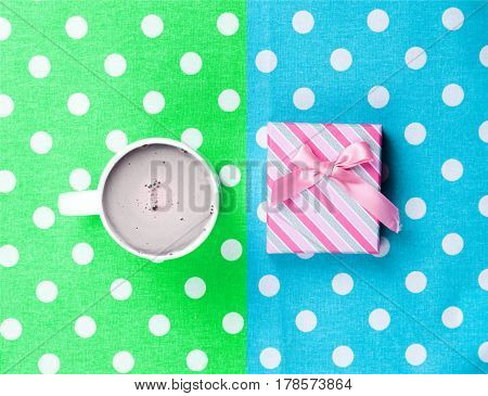 Photo Of Cup Of Coffee And Cute Gift On The Wonderful Colorful Dotted Background In Pop Art Style