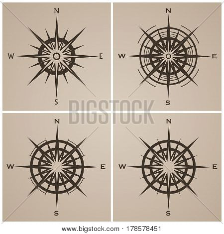 Set of isolated compass roses or windroses. Vector illustration.
