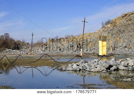 Granite quarry. Electric posts in quarry. Quarry landscape.