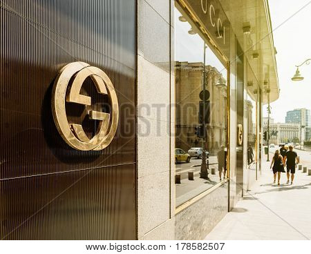 BUCHAREST FRANCE - APR 1 2016: Gucci sign logo on fashion store official boutique flagship store in Bucharest. Gucci is a luxury brand known for modern Italian-crafted leather goods apparel & accessories for men & women