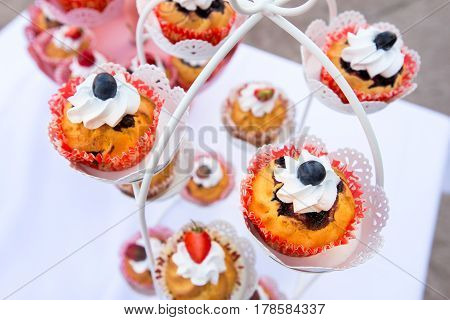 Cupcakes with cream and berries Candy Bar blueberries strawberries cherries
