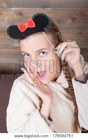 Young cute girl with funny hairstyle on a stick
