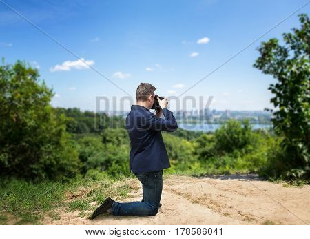 Male photographer taking picture of cityscape