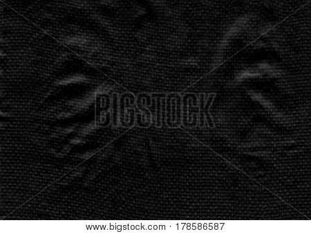 Abstract black texture background with black crumpled cotton textile